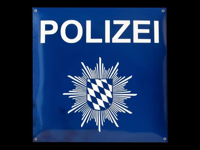 Firmenschild-Polizei